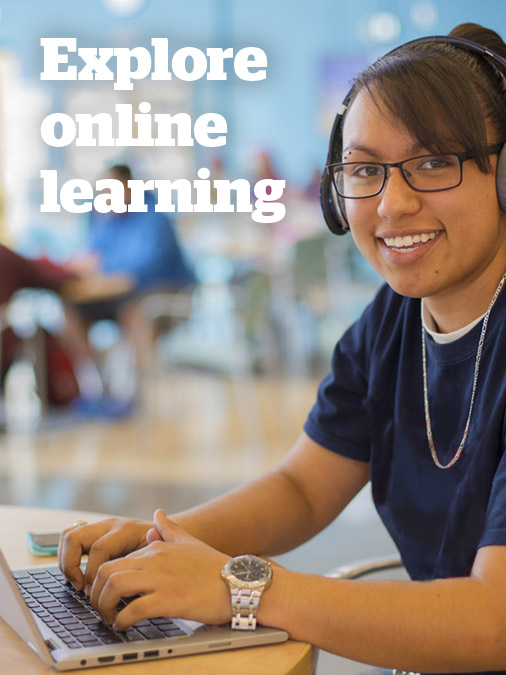 Explore online learning - female student using laptop