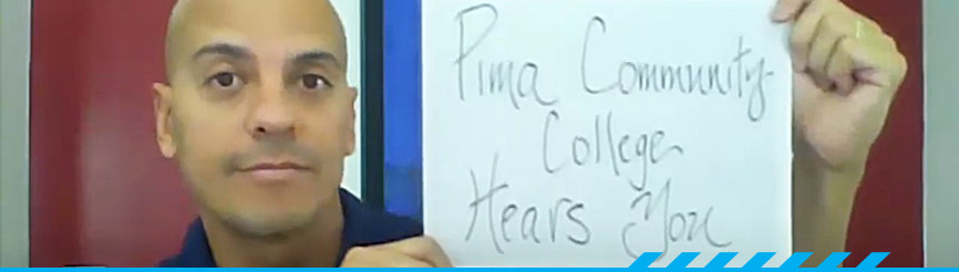 PCC employee holding up sign stating Pima Community College Hears You
